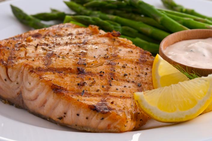 Our freshly prepared fish is paired with fresh lemon wedges to add a special touch and asparagus.